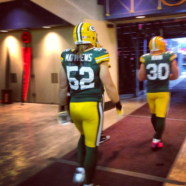 LB Clay Matthews and FB John Kuhn head out the tunnel to the field
