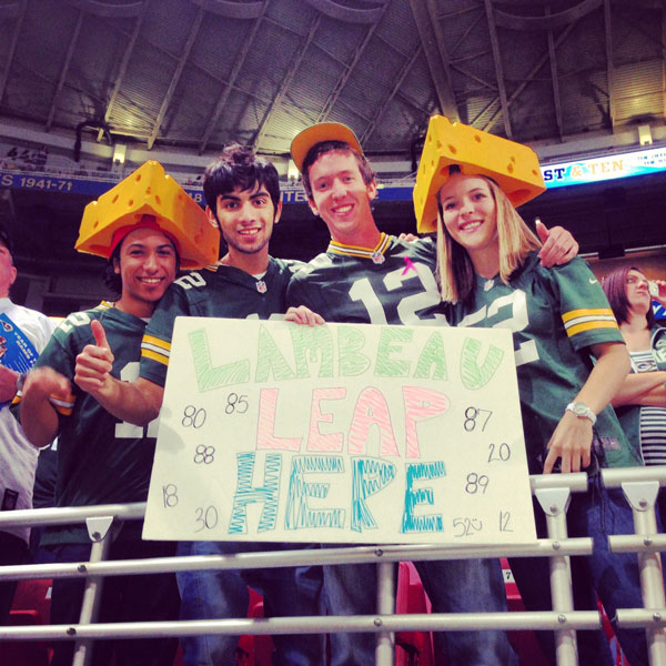 Packers fans seated in the end zone hope to get close to the action Sunday