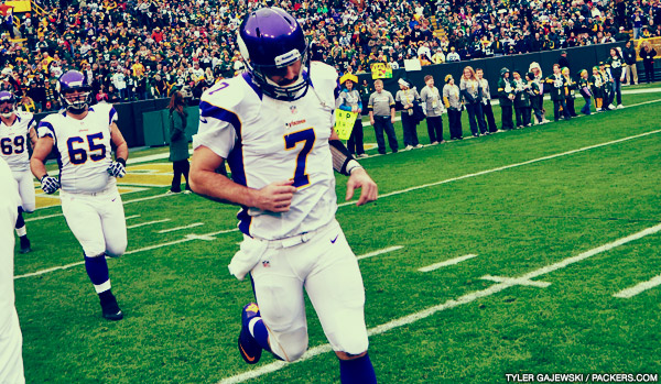 Minnesota Vikings QB Christian Ponder runs out of the tunnel at Lambeau Field