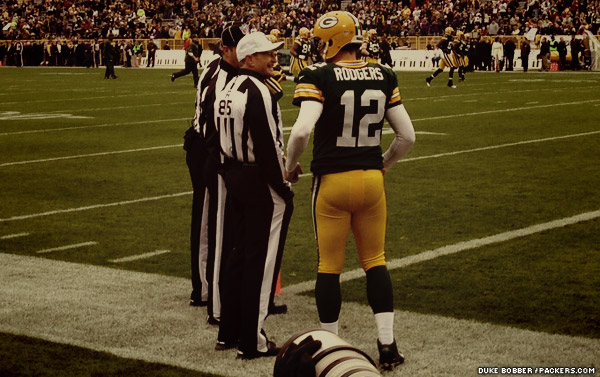 Packers QB Aaron Rodgers, who turned 29 Sunday, chats with an official before kickoff