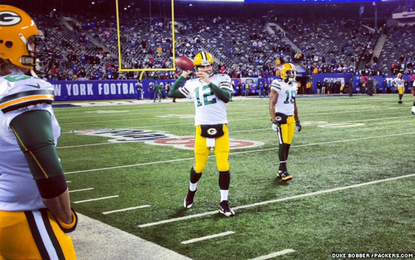 Green Bay Packers QB Aaron Rodgers and WR Randall Cobb warm up before the game