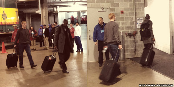 Green Bay Packers P Tim Masthay and DB Charles Woodson walk into the locker room at Soldier Field