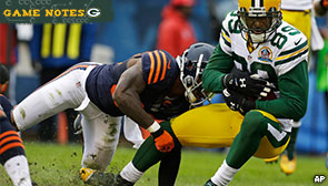 Wide receiver James Jones hit by the defense