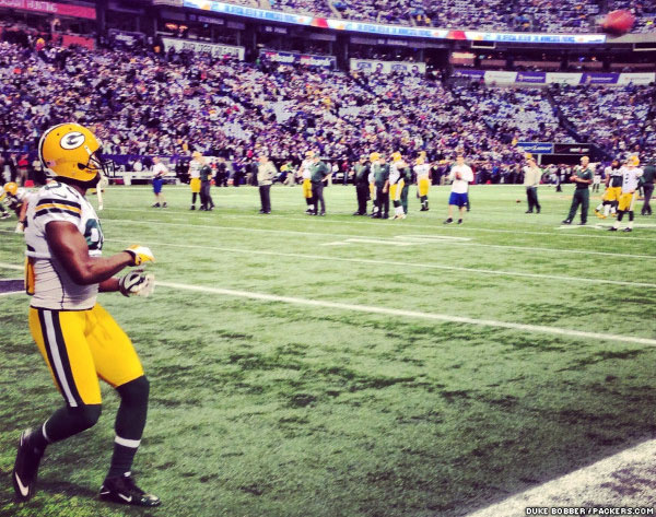 Greg Jennings waits for an Aaron Rodgers throw during warm-ups