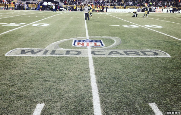 "The NFL ""WIld Card"" playoffs logo is painted onto the grass at Lambeau Field"