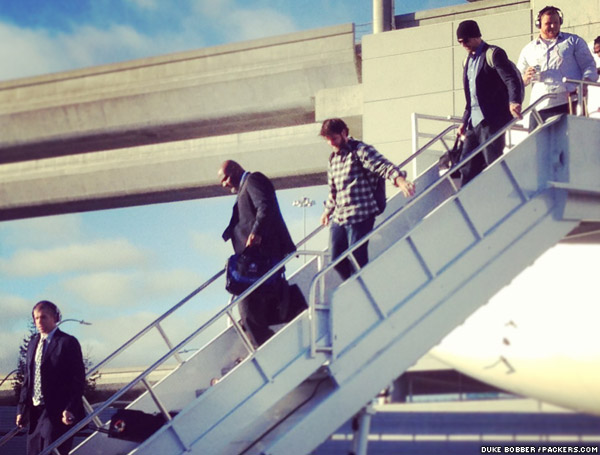 WR Jordy Nelson, Rob Davis, QB Graham Harrell, QB Aaron Rodgers and G T.J. Lang exit the team plane