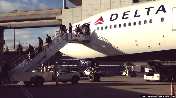Packers players, coaches and staff get off the team charter at San Francisco International Airport (SFO) Friday afternoon