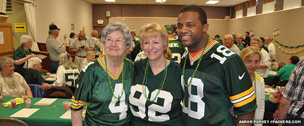 Green Bay Packers wide receiver Randall Cobb poses for a picture with fans.
