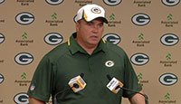 Head Coach Mike McCarthy at the podium