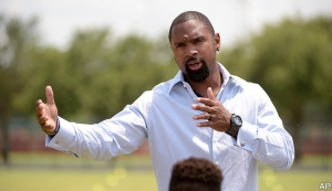 Former NFL defensive back Charles Woodson addresses members of the Edgewater High School football team before a news conference announcing Orlando, Fla., as the new host for the NFL Pro Bowl football game in Kissimmee, Fla., Wednesday, June 1, 2016. (AP Photo/Phelan M. Ebenhack)